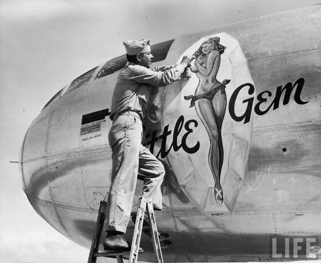 Fighting aircraft nose art pinup